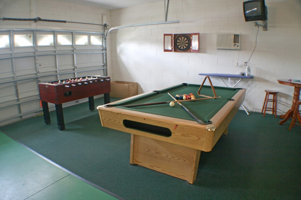 A garage with a Games Room Theme