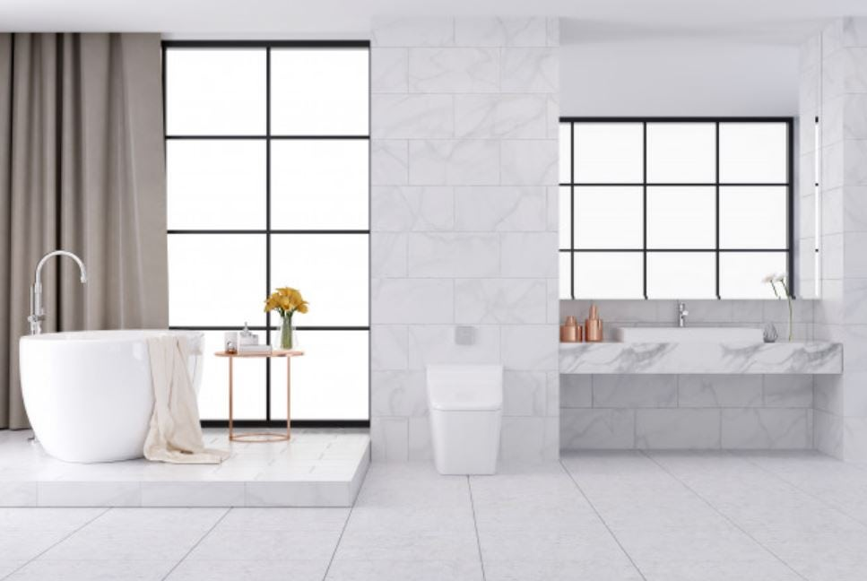 bathroom with white tiles, white bath, windows, vanity, toilet